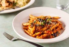 Italian Puttanesca Pasta Dish. At a Local Restaurant stock photos