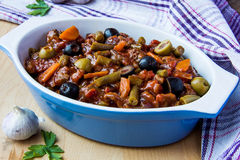 Italian ragout. Stew with meat, vegetables and olive Stock Image