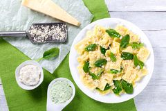 Italian ravioli with creamy spinach sauce, top view Royalty Free Stock Images