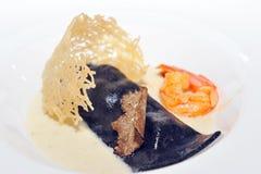 Italian ravioli with seafood and truffles Royalty Free Stock Photo