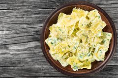 Italian ravioli smothered in creamy spinach sauce, top view Royalty Free Stock Photos