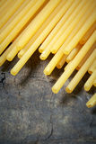 Italian raw pasta. Close up of Italian raw pasta on wood Royalty Free Stock Photos