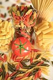 Italian raw pasta with tomatoes Stock Photography