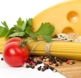 Italian raw pasta with tomatoes, cheese. And spices Royalty Free Stock Photos