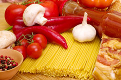 Italian raw pasta with tomatoes, cheese Royalty Free Stock Image