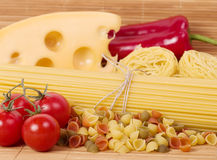 Italian raw pasta with tomatoes, cheese. And spices Royalty Free Stock Images