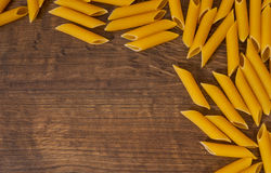 Italian raw rigatoni pasta on wooden table with copy space. top view Stock Photo