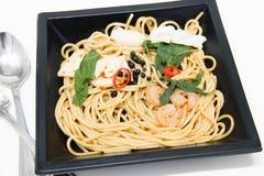 Italian recipe: spaghetti and seafood Stock Photos