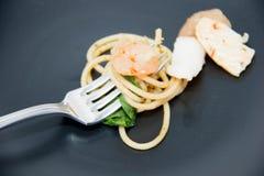 Italian recipe: spaghetti and seafood Stock Images