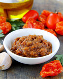 Italian red pesto of sun-dried tomatoes with garlic Royalty Free Stock Image