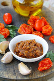 Italian red pesto of sun-dried tomatoes with garlic Royalty Free Stock Images