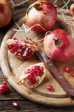Italian red pomegranate on the wooden table Royalty Free Stock Images