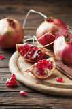Italian red pomegranate on the wooden table Royalty Free Stock Photo