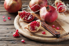 Italian red pomegranate on the wooden table Royalty Free Stock Image