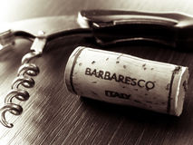 Italian red wine. A detail of a corkscrew and a cork from a bottle of Italian Barbaresco, a red wine from Piedmont stock photography