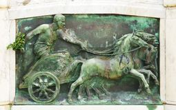 A chariot man. An Italian relief with a chariot driver Royalty Free Stock Images