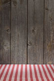 Italian Restaurant Background. A background with a red checked tablecloth and wood panel with a classic old Italian feel Stock Images