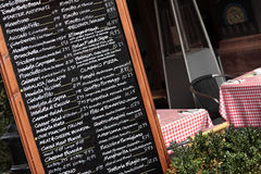 Italian restaurant with chalk menu board, sidewalk cafe Royalty Free Stock Photo