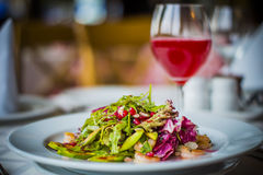 Italian restaurant. Salad with shrimp photo by ZVEREVA Stock Images