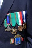 An Italian retired sailor shows his medals Stock Photos