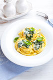 Italian ribbon pasta with gorgonzola sauce. And spinach royalty free stock images