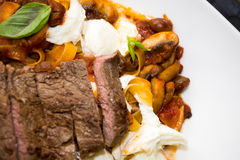 Italian ribbon pasta with grilled beef steak Stock Photos