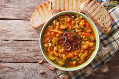 Italian ribollita vegetable soup close up in a bowl. Horizontal. Italian ribollita vegetable soup close up in a bowl on the table. Horizontal view from above Royalty Free Stock Photo