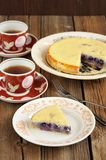 Italian ricotta pie with blueberries and black tea on wooden bac Royalty Free Stock Photos