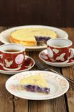 Italian ricotta pie with blueberries and black tea on wooden bac Stock Photo