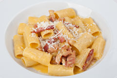 Italian rigatoni plate with prosciutto, parmesan cheese Royalty Free Stock Photo