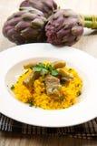 Italian risotto with artichoke. Italian risotto with saffron and artichokes Royalty Free Stock Images