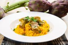 Italian risotto with artichokes. An Italian risotto with artichokes Royalty Free Stock Images