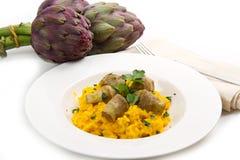 Italian risotto with artichokes. Italian risotto with saffron and artichokes Stock Photography