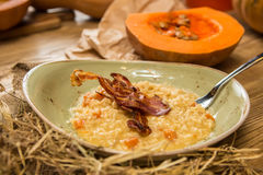 Italian risotto with grilled mushrooms and bacon Stock Photography