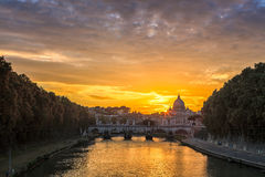 Italian River with Stone Bridge During Sunset. Beautiful River at Rome Italy with View Vintage Stone Arch Bridge with Basilica of Saint Peter. Capturing During Royalty Free Stock Image