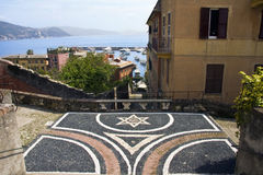 Italian Riviera. Landscape of Italian Riviera and a mosaic star to the fore stock images