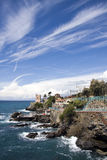 Italian riviera coast. A promenade on the rocks leads to the tower Royalty Free Stock Images