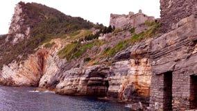 Italian Riviera Coastline. View of the Italian Riviera rocky coast from a boat Stock Photo