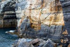 Italian Riviera Coastline. View of the Italian Riviera rocky coast from a boat Royalty Free Stock Photos