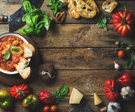 Italian roasted tomato and garlic soup with bread, basil, parmesan Royalty Free Stock Image