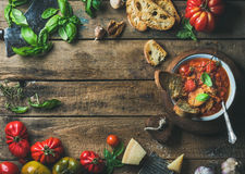 Italian roasted tomato and garlic soup with bread, basil, parmesan Royalty Free Stock Photography