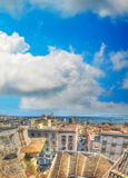 Italian roofs by the sea under a cloudy sky Royalty Free Stock Image