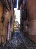 Italian rustic streets and ancient. Foreshortening of small pedestrian streets of Malcesine town on Lake Garda Stock Images