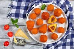 Italian saffron risotto cone and balls Royalty Free Stock Photos