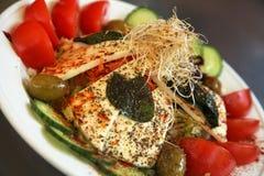 Italian salad. Healthy salad with Italian mozzarella cheese, olives, cucumbers and tomatoes Stock Photo