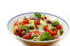 Italian salad. In a bowl, against a white background Royalty Free Stock Photos