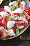 Italian salad caprese with ham, basil and mozzarella Stock Images