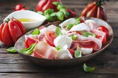 Italian salad caprese with ham and mozzarella Stock Photography