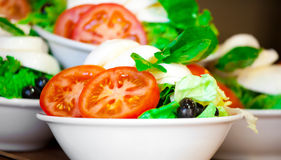 Italian salad from cherry tomatoes, a mozzarella and lettuce in Stock Photos