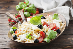 Italian Salad with cold pasta and mozzarella. Selective focus Stock Photos